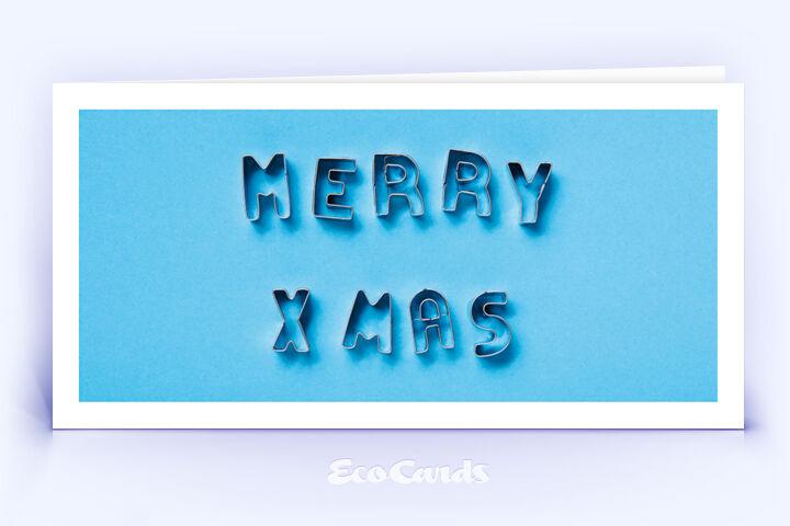 Öko Weihnachtskarte Nr. 1514 blau mit Ausstechformen, die zu einem Weihnachtsgruß zusammengelegt sind, ist mit einem ausgefallenen Motiv versehen.