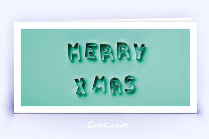 Öko Weihnachtskarte Nr. 1526 tuerkis mit Ausstechformen für Plätzchen, die zu einem Weihnachtsgruß zusammengelegt sind, ist mit einem modernen Kartenmotiv versehen.